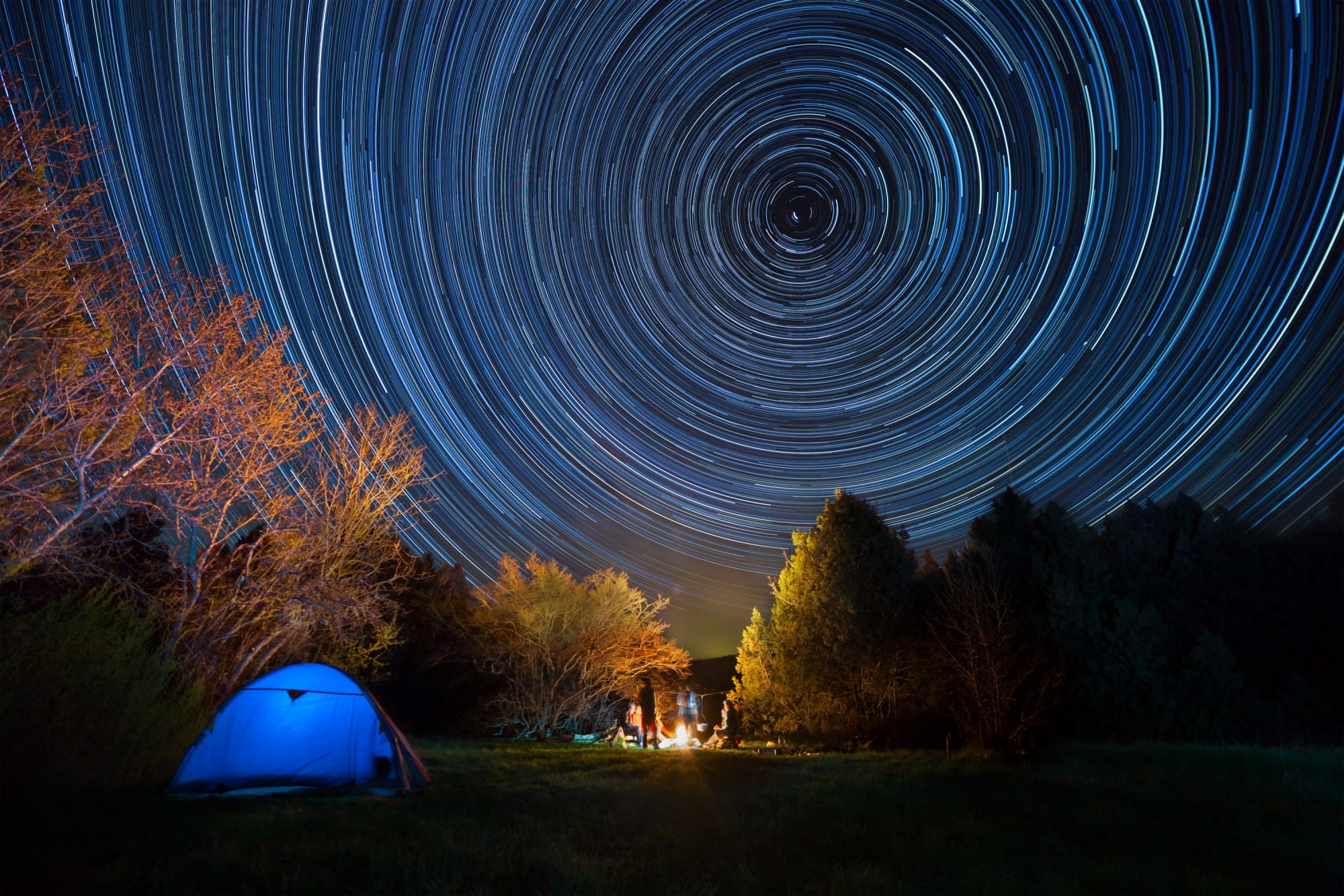 tent-against-the-night-sky-with-tracks-from-stars-l-e1434422208961